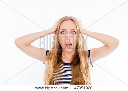 Portrait Of Young Angry Shocked Woman Holding Head