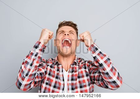 Agressive Furious Businessman With Big Problems Shouting With Raised Fists