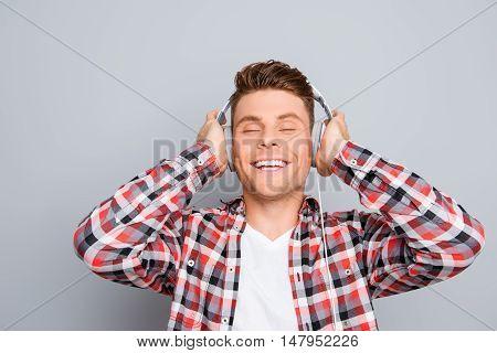 Portrait Of Happy Music Lover Listening Music In Headphones