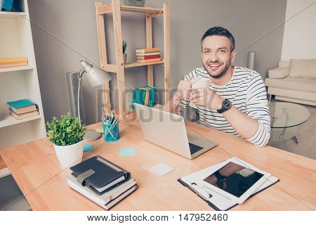 Happy Man Have Rest And Drink Coffee In Office