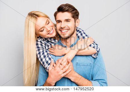 Smiling Man Piggybacking His Girl And She Huging Him