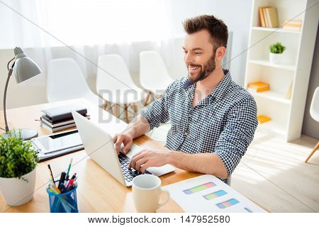Happy Successful Businessman Working In Office On Laptop
