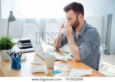 Businessman Having Cold In The Head And Sitting At Workplace .