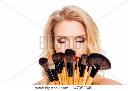 Portrait Of Young Pretty Woman Holding Makeup Brushes