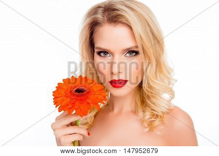 Portrait Of Beautiful Smiling Young Woman With Orange Gerbera