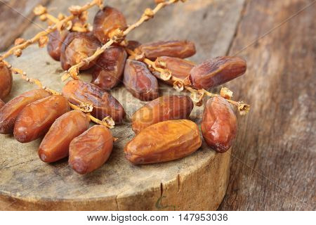 Dried date palm. fruit Delicious fresh organic on the wooden floor