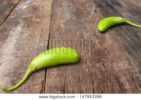 green eggplant. Fresh veggies on a wooden table. (Solanum melongena ) : Select focus front Eggplant with shallow depth of field. and copy space.