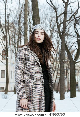 young pretty stylish modern hipster girl outside on street, fashion coat, hairstyle, make up, lifestyle people concept close up citylife winter
