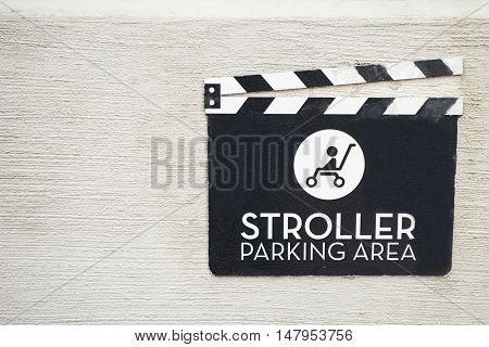 Stroller parking sign on the wall background