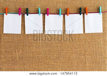 Neat Row Of Hanging Blank White Notepads