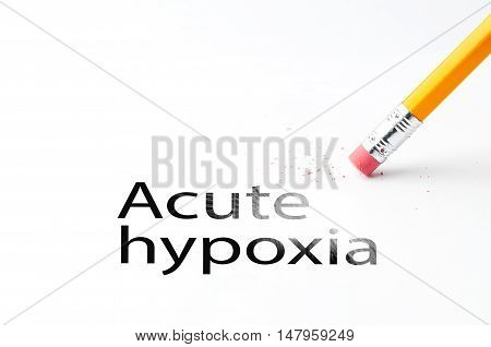 Closeup of pencil eraser and black Acute hypoxia text. Acute hypoxia. Pencil with eraser.