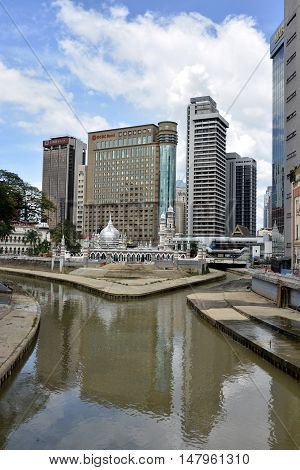 Kuala Lumpur, Malaysia - November 29, 2015. The confluence of Klang and Gombak Rivers in Kuala Lumpur, with historic and commercial buildings. The city, literally meaning muddy confluence in Malay, was founded at the confluence of these two rivers in 1857