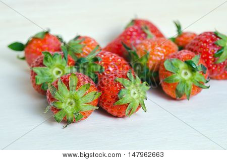 Group Of Of Red Ripe Strawberry Fruit On Wooden Board (also Known As Fragaria Strawberry, Fragaria A
