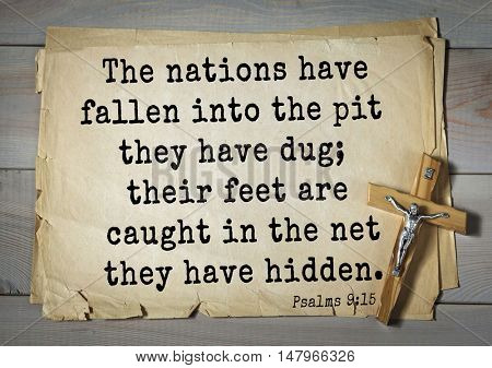 TOP-1000.  Bible verses from Psalms. The nations have fallen into the pit they have dug; their feet are caught in the net they have hidden.