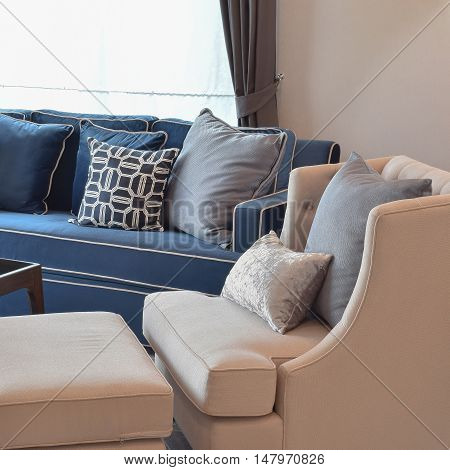 Beige Classic Sofa And Blue Pattern Pillows In Warm Living Room
