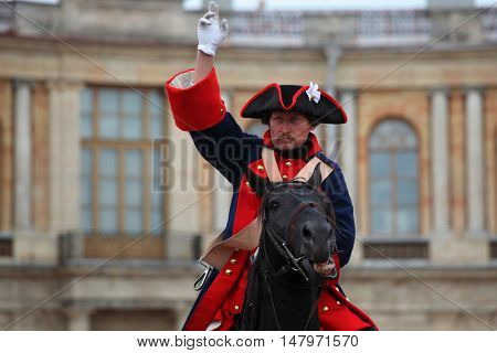 GATCHINA, ST. PETERSBURG, RUSSIA - SEPTEMBER 10, 2016: Actor in retro uniform of Russian army on the platz in front of Gatchina palace during the festival Gatchinskaya Byl