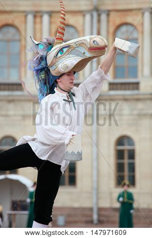 GATCHINA, ST. PETERSBURG, RUSSIA - SEPTEMBER 10, 2016: Actor in images of unicorn in the show during the festival Gatchinskaya Byl. The festival is held first time this year