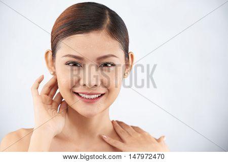 Beautiful young woman with fresh moisturized skin