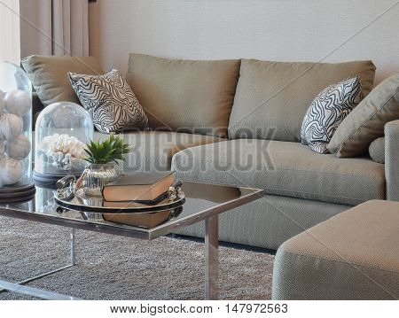 Comfortable Velvet Sofa With Grey Striped Pillows In Modern Living Room
