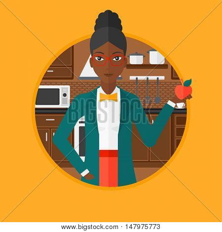 An african-american woman holding an apple in the kitchen. Young woman eating an apple in the kitchen. Woman with an apple at home. Vector flat design illustration in the circle isolated on background
