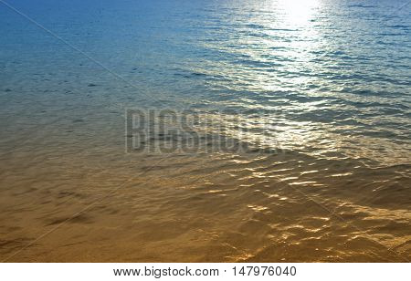 Sunrise reflective light background. Morning at sea beautiful colorful water ( Cold Warm Filter) : copy space for add text above