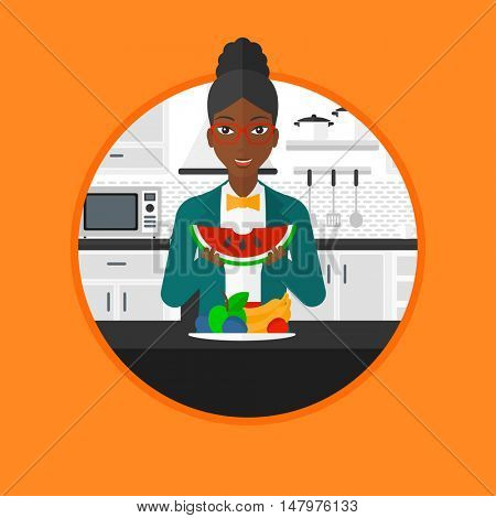 An african woman eating watermelon in front of table full of fresh fruits. Woman holding a slice of watermelon in the kitchen. Vector flat design illustration in the circle isolated on background.