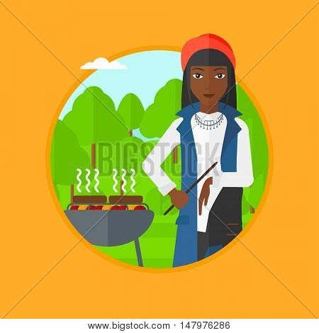 An african woman sitting next to barbecue grill in the park. Woman cooking meat on barbecue grill. Woman having barbecue party. Vector flat design illustration in the circle isolated on background.