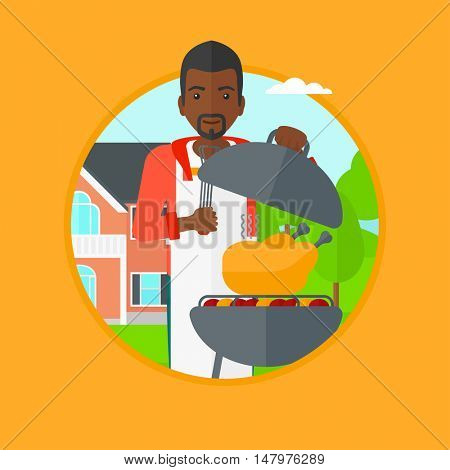 African-american man cooking chicken on barbecue grill in the backyard. Man having barbecue party. Man preparing chicken on grill. Vector flat design illustration in the circle isolated on background.