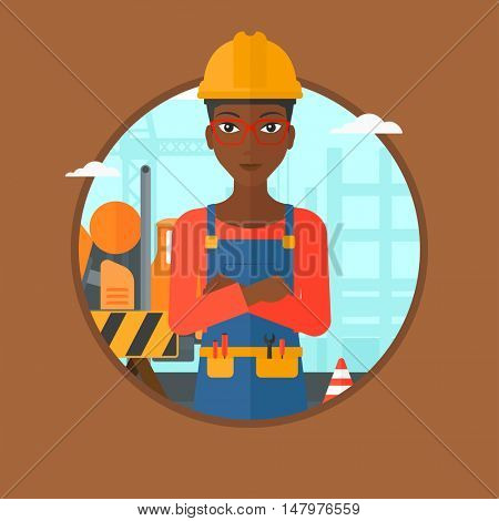 An african-american female confident builder in hard hat with arms crossed standing on a background of construction site. Vector flat design illustration in the circle isolated on background.