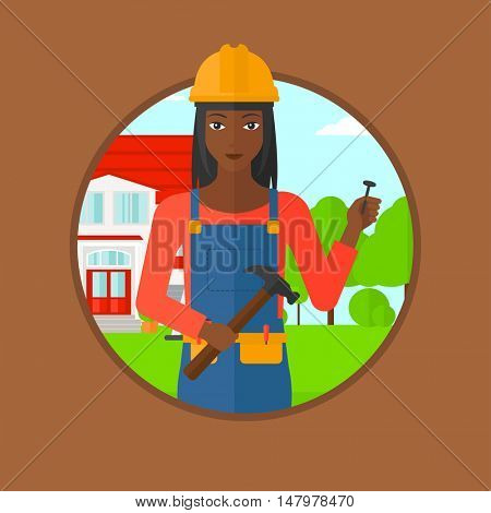 African-american female builder in uniform and helmet. A builder with hummer and nail in hands. Builder on a background of house. Vector flat design illustration in the circle isolated on background.