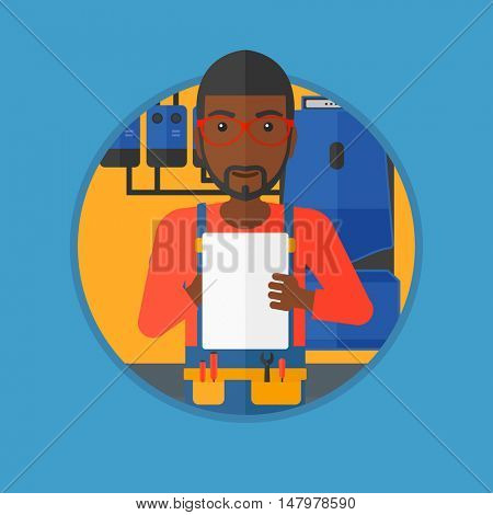 An african-american young plumber in overalls making some notes in his clipboard. Plumber inspecting heating system in boiler room. Vector flat design illustration in the circle isolated on background