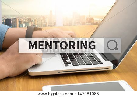 MENTORING SEARCH WEBSITE INTERNET SEARCHING businessman work hard and use computer