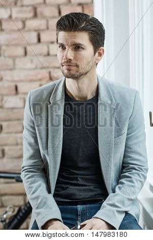 Portrait of casual young man thinking, looking away.