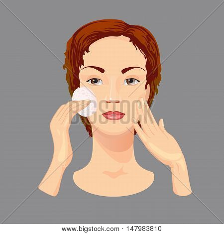 Young woman  cleans her face with cosmetic lotion. Female is taking care of her face skin.