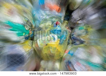 Close Up of garbage and waste in transparent bags with motion effect.