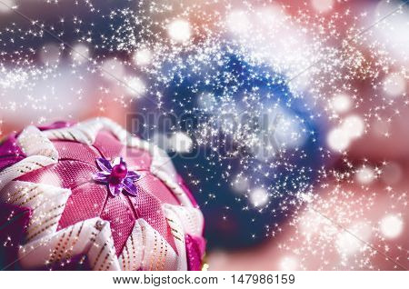 Christmas background, decoration. Christmas balls on a wooden table. Soft focus. Sparkles and bubbles. Abstract background. Vintage