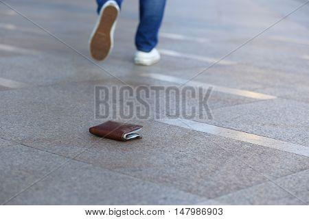 people walking on street lost wallet with money