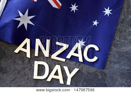 Anzac Day signage with an Australian flag.