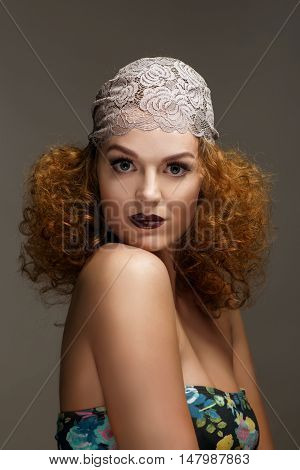Old-fashioned red-haired woman with professional make up and hairstyle