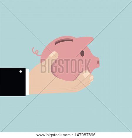 Saving the money in piggy bank. Saving money concept.