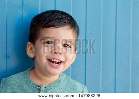 Cheerful child with two years making gestures on the street