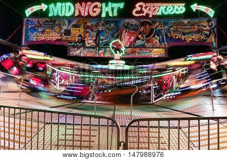 Charters Towers Australia: August 2 2016 - A colourful carnival ride Midnight Express going at high speed at the local show.