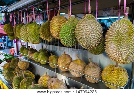 Durian fruits hanging at street food stall in China town