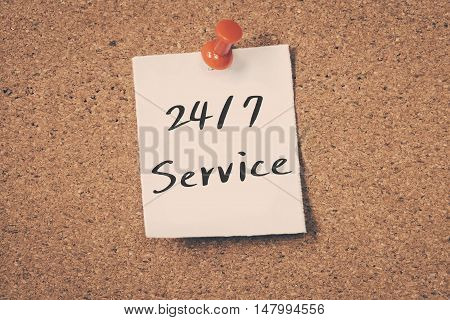 24/7 service note pin on the bulletin board