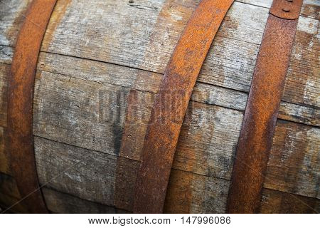 storage, container and object concept - close up of old wooden barrel with rusty hoops outdoors