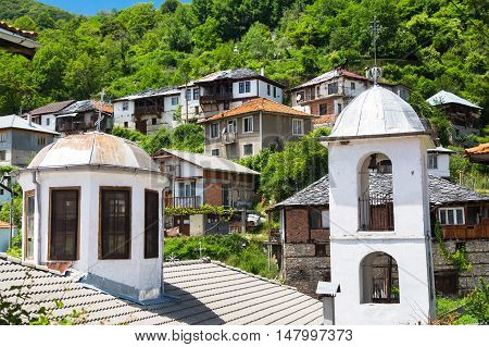 Aerial panorama of church tower and houses in high mountain village or selo Delchevo, Bulgaria, Balkans