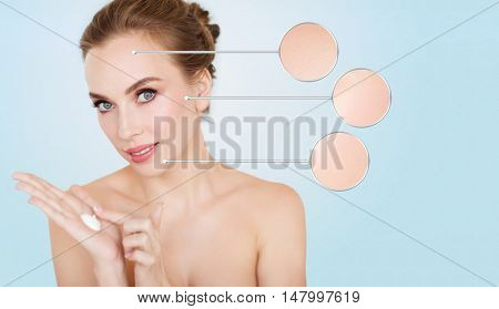 beauty, people, skincare and cosmetics concept - happy young woman with moisturizing blue on hand
