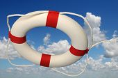 Life preserver with rope against a sky