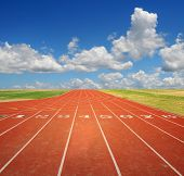 stock photo of 8-track  - Running track with eight lanes with sky and clouds - JPG