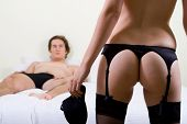 stock photo of strip tease  - sexual teaser - JPG